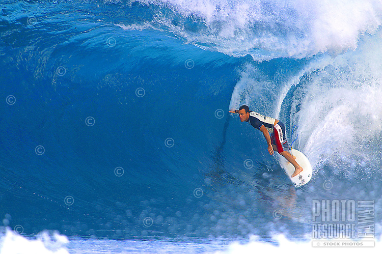surfing big waves on the north shore
