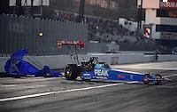 Nov. 10, 2012; Pomona, CA, USA: NHRA top fuel dragster driver T.J. Zizzo during qualifying for the Auto Club Finals at at Auto Club Raceway at Pomona. Mandatory Credit: Mark J. Rebilas-