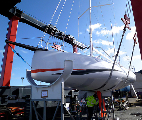 This is how it was, In Real Time – the new Sun Fast 3300 Cinnamon Girl gets ready for her splash at MGM Boats in early March, 2020. Photo: W M Nixon
