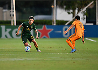 LAKE BUENA VISTA, FL - JULY 18: Pablo Bonilla #28 of the Portland Timbers dribbles away from Memo Rodríguez #8 of the Houston Dynamo during a game between Houston Dynamo and Portland Timbers at ESPN Wide World of Sports on July 18, 2020 in Lake Buena Vista, Florida.