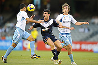 MELBOURNE, AUSTRALIA - FEBRUARY 18, 2010: Nik Mrdja from Melbourne Victory watches the ball in the first leg of the A-League Major Semi Final match between the Melbourne Victory and Sydney FC at Etihad Stadium on February 18, 2010 in Melbourne, Australia. Photo Sydney Low www.syd-low.com