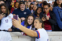 HOUSTON, TX - FEBRUARY 03: Tobin Heath #17 of the United States takes a selfie with fans during a game between Costa Rica and USWNT at BBVA Stadium on February 03, 2020 in Houston, Texas.