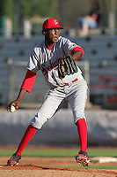 Spokane Indians pitcher Santo Perez #6 pitches against the Salem-Keizer Volcanoes at Volcanoes Stadium on August 10, 2011 in Salem-Keizer,Oregon. Salem-Keizer defeated Spokane 7-6.(Larry Goren/Four Seam Images)