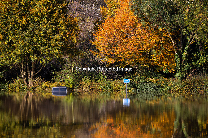 28/10/19<br /> <br /> At first these stunning autumn colours reflected in water in Shrewsbury, Shropshire, make for a beautiful scene, but on closer inspection a van and a car can be seen submerged in the town's car park after the river Severn burst its banks.<br /> <br /> All Rights Reserved: F Stop Press Ltd.  <br /> +44 (0)7765 242650 www.fstoppress.com
