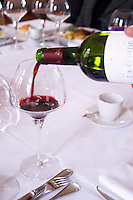 wine poured in a glass at the table chateau la garde pessac leognan graves bordeaux france