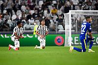 29th September 2021; Turin, Italy;   Juventus FC versus Chelsea FC - UEFA Champions League;  Juan Cuadrado and Danilo Luiz da Silva of Juventus FC on his knees prior to the UEFA Champions League football match