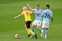 Will Hughes of Watford pushes away Kevin De Bruyne of Man City during the Premier League match between Watford and Manchester City at Vicarage Road, Watford, England on 21 July 2020. Football Stadiums around remain empty due to the Covid-19 Pandemic as Government social distancing laws prohibit supporters inside venues resulting in all fixtures being played behind closed doors until further notice.<br /> Photo by Andy Rowland.