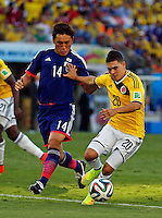 Juan Quintero y Toshihiro Aoyama CUIABA -  BRASIL -24-06-2014.  Foto: Daniel Jayo / Archivolatino<br /> Juan Quintero (#20) jugador de Colombia (COL) disputa el balón con Toshihiro Aoyama (#14) jugador de Japón (JPN) durante partido del Grupo C de la Copa Mundial de la FIFA Brasil 2014 jugado en el estadio Arena Pantanal de Cuiaba./ Juan Quintero (#20) player of Colombia (COL) fights the ball with Toshihiro Aoyamaa (#14) player of Japan (JPN) during the match of the Group C of the 2014 FIFA World Cup Brazil played at Arena Pantanal stadium in Cuiaba. Photo: Daniel Jayo / Archivo Latino<br /> VizzorImage PROVIDES THE ACCESS TO THIS PHOTOGRAPH ONLY AS A PRESS AND EDITORIAL SERVICE IN COLOMBIA AND NOT IS THE OWNER OF COPYRIGHT; ANOTHER USE IS REPONSABILITY OF THE END USER. NO SALES, NO MERCHANDASING. ALL COPYRIGHT IS ARCHIVOLATINO