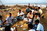 Men playing cards at Velankanni beach.Nagapattinam.India.