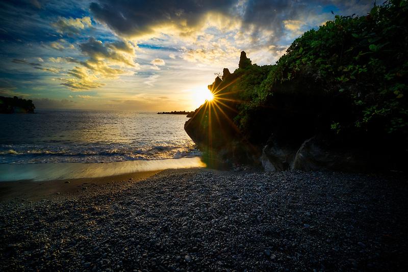 Black Sand Beach with sunrise. Waianapanapa State Park, Maui, Hawaii.