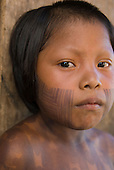 Mato Grosso State, Brazil. Aldeia Piaracu; Kayapo girl with face paint.