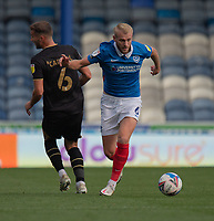 Portsmouth's Jack Whatmough (right) holds off the challenge from Milton Keynes Dons' Baily Cargill (left) <br /> <br /> Photographer David Horton/CameraSport<br /> <br /> The EFL Sky Bet League One - Portsmouth v Milton Keynes Dons - Saturday 10th October 2020 - Fratton Park - Portsmouth<br /> <br /> World Copyright © 2020 CameraSport. All rights reserved. 43 Linden Ave. Countesthorpe. Leicester. England. LE8 5PG - Tel: +44 (0) 116 277 4147 - admin@camerasport.com - www.camerasport.com