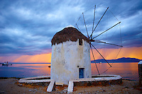 Sunset over the traditional Greek windmills of Mykonos Chora. Cyclades Islands, Greece