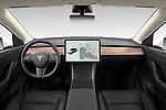 Stock photo of straight dashboard view of 2021 Tesla Model-Y Long-Range-AWD 5 Door SUV Dashboard