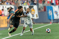 FOXBOROUGH, MA - AUGUST 3: Carlos Vela #10 of Los Angeles FC attempts to control the ball as Edgar Castillo #8 of New England Revolution defends during a game between Los Angeles FC and New England Revolution at Gillette Stadium on August 3, 2019 in Foxborough, Massachusetts.
