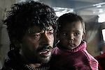 A man and his daughter who in February 2012 lived in a Roma settlement under a highway bridge in Belgrade, Serbia. The families that lived here, most of whom survive from recycling cardboard and other materials, were forcibly evicted in April 2012. Many were moved into metal shipping containers on the edge of Belgrade..