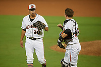 Delmarva Shorebirds pitcher Matt De La Rosa (30) fist bumps catcher Adley Rutschman (37) during a South Atlantic League game against the Greensboro Grasshoppers on August 21, 2019 at Arthur W. Perdue Stadium in Salisbury, Maryland.  Delmarva defeated Greensboro 1-0.  (Mike Janes/Four Seam Images)