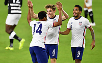 ORLANDO CITY, FL - JANUARY 31: Jonathan Lewis #14 of the United States celebrates his goal with Sam Vines #4 during a game between Trinidad and Tobago and USMNT at Exploria stadium on January 31, 2021 in Orlando City, Florida.