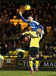 Rob Kiernan wins the ball above Hugo Faria