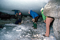 Tourists on an Ice Walk, exploring under the Ice at the River Bottom of Maligne Canyon, in Jasper National Park in the Canadian Rockies, Alberta, Canada