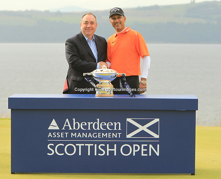 The 2012 Aberdeen Asset Management Scottish Open Champion is Jeev Milkha Singh from India with a score of 17 under par is here with The Rt Hon Alex Salmond, First Minister of Scotland.  The event was staged over the links at Castle Stuart, Inverness, Scotland from 12th to 15th July 2012:  Stuart Adams www.golftourimages.com:15th July 2012