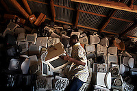 Computer monitors are piled high at an importer's warehouse in Accra. The majority of them are not working and will be scrapped. Containers arriving in Ghana with computers are often labelled second hand goods so as to bypass international laws, but in reality as much as 80 percent of the equipment will be obsolete or broken.