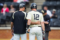 Wake Forest Demon Deacons head coach Tom Walter (16) has a chat with Joe Napolitano (12) during the game against the Virginia Cavaliers at Wake Forest Baseball Park on May 17, 2014 in Winston-Salem, North Carolina.  The Demon Deacons defeated the Cavaliers 4-3.  (Brian Westerholt/Four Seam Images)