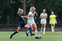 NEWTON, MA - AUGUST 29: Abby McNamara #17 of Boston College brings the ball forward as Chloe Landers #2 of University of Connecticut defends during a game between University of Connecticut and Boston College at Newton Campus Soccer Field on August 29, 2021 in Newton, Massachusetts.
