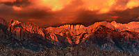 902000022 panoramic view - dawn light turns the eastern sierras and storm clouds alpenglow pink in the alabama hills blm lands in california