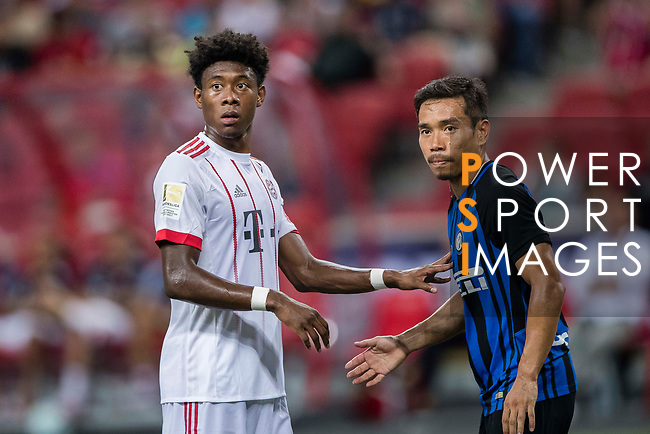 FC Internazionale Defender Yuto Nagatomo (R) fights for position with Bayern Munich Defender David Alaba (L) during the International Champions Cup match between FC Bayern and FC Internazionale at National Stadium on July 27, 2017 in Singapore. Photo by Marcio Rodrigo Machado / Power Sport Images