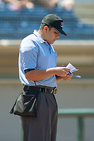 Home plate umpire Luis Hernandez looks at the line up cards prior to the game between the Lake Elsinore Storm and the Rancho Cucamonga Quakes at LoanMart Field on May 28, 2018 in Rancho Cucamonga, California. The Storm defeated the Quakes 8-5.  (Donn Parris/Four Seam Images)