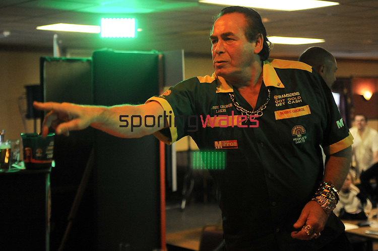 Bobby George during the John Smith's People's Darts Welsh Regional Final..John Smith's People's Darts Regional Final - Caerphilly - Wales. 21st November 2010.  Please Credit - Ian Cook - Sportingwales