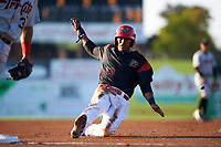 Batavia Muckdogs right fielder Jhonny Santos (13) slides into third base during a game against the Tri-City ValleyCats on July 15, 2017 at Dwyer Stadium in Batavia, New York.  Tri-City defeated Batavia 5-4.  (Mike Janes/Four Seam Images)