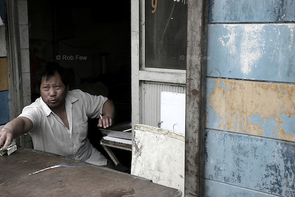 Street vendor in a Beijing hutong (traditional residential area).
