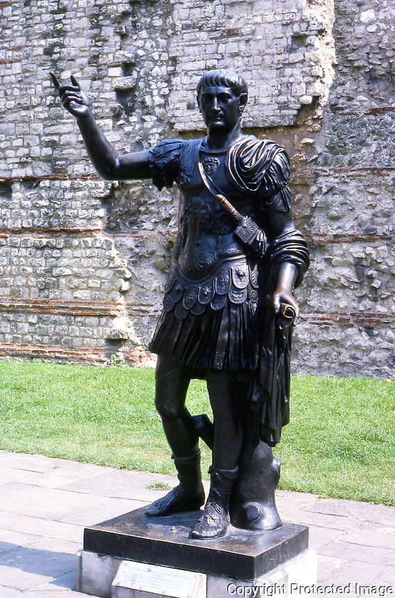 Greek Art:  London Bronze, believed to be Trajan. About 5 ft. tall.  Roman wall in background.
