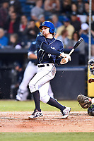 Asheville Tourists shortstop Ryan Vilade (4) swings at a pitch during a game against the Columbia Fireflies at McCormick Field on April 12, 2018 in Asheville, North Carolina. The Fireflies defeated the Tourists 7-5. (Tony Farlow/Four Seam Images)
