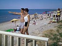 Surfcomber Motel couple on the beach.