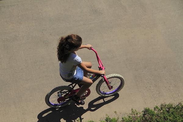 303-530-3357, John@OutsideImagery, Outside Imagery, Confluence Park, Denver, Colorado,  John Kieffer (photographer), Kieffer (photographer), person, people, urban, city, sidewalk, walk, biking, young girl, female, girl
