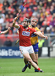 Mark Ellis of Cork in action against Peter Duggan of Clare during their Munster Senior game at Pairc Ui Chaoimh. Photograph by John Kelly.