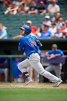 Iowa Cubs right fielder Bijan Rademacher (24) follows through on a swing during a game against the Memphis Redbirds on May 29, 2017 at AutoZone Park in Memphis, Tennessee.  Memphis defeated Iowa 6-5.  (Mike Janes/Four Seam Images)