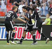 April 2, 2006: Washington, DC: DC United forward (11) Alecko Eskandarian celebrates his goal with teammates while playing the New York Red Bulls at RFK Stadium.  The game ended in a tie, 2-2.