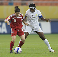 Canada midfielder (8) Diana Matheson keeps her distance form Ghana captain (10) Adjoa Bayor during their first round game at the 2007 FIFA Women's World Cup at Hangzhou Dragon Stadium in Hangzhou, China.  Canada defeated Ghana, 4-0.