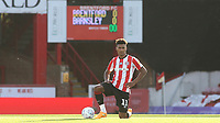 Brentford's Ollie Watkins takes a knee ahead of kick-off during Brentford vs Barnsley, Sky Bet EFL Championship Football at Griffin Park on 22nd July 2020