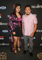 HOLLYWOOD, CA - OCTOBER 12: Maria Padilla, Julio Padilla, at the 21st Screamfest Opening Night Screening Of The Retaliators at Mann Chinese 6 Theatre in Hollywood, California on October 12, 2021. Credit: Faye Sadou/MediaPunch