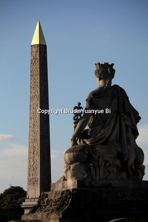 Statue representing French city in Concorde Square Place de la Concorde with Obelisk in the background. Paris. France
