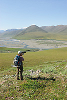 Georgia Bennett takes a photo of the scenery along the Kongakut River, in Alaska's Arctic National Wildlife Refuge.