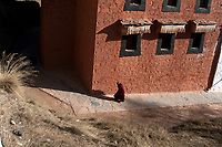 A Tibetan monk at Labrang (Chinese Name - Xiahe) Monastery on the Qinghai-Tibetan Plateau. China.