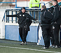 Shire manager Craig Tully shares a joke with Montrose manager George Shields.