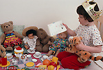 girl 4 years old pretend play tea party w. dolls & stuffed animals reading invitation horizontal