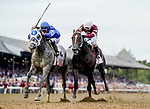 August 28, 2021: Essential Quality #2, ridden by jockey Luis Saez holds off a stubborn Midnight Bourbon #1 ridden by jockey Ricardo Santana Junior to win the Grade 1 Travers Stakes at Saratoga Race Course in Saratoga Springs, N.Y. on August 28th, 2021. Scott Serio/Eclipse Sportswire/CSM